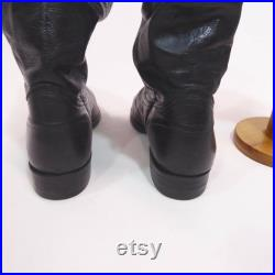 1970's black leather boots. Unisex. made in Canada. Man 7 1 2. classic rock. androgyne.santiags straight edge with 2 loops.