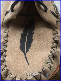 Lowlander with Western swing moccasin